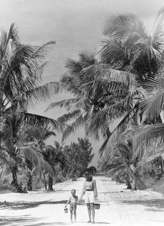 Florida Memory - 1948 Elizabeth Fletcher and Paul Fletcher, Jr. walk down island road to beach for shell collecting - Sanibel Island, Florida Vintage Florida, Old Florida, Florida Girl, Florida Woman, Clearwater Florida, Sarasota Florida, Florida Beaches, Kissimmee Florida, Sanibel Island
