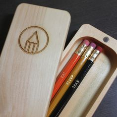 Pencil Pod  Your favorite tools when you need them.  Pencil Pod from EatSleepDraw.  The Pencil Pod is hand crafted in the U.S.A. with eastern white pine.  It's designed to open up completely. The hinge is composed of incredibly strong rare earth magnets and the wood is finished with Danish oil. The EatSleepDraw emblem is laser engraved into the top.   The three EatSleepDraw pencils are included with each order.  It can hold approximately 10 pencils.   Measures approx. 9 in. x 2.5 in. x 1 in…