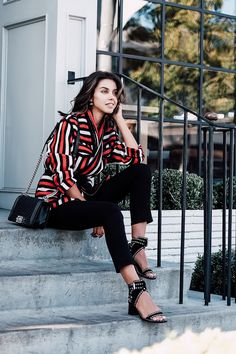 Casual look: Pair a red, white and black Isabel Marant blanket coat with cropped black jeans and studded sandals