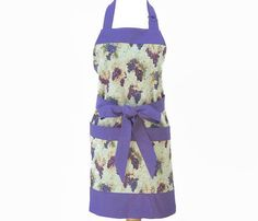Womens chef apron in a very pretty purple and blue/green grapes themed cotton print, accented in solid purple. Fits up to about US size 12/14 (apron waist- 29/73.6 cm; Length- 29/73.6 cm (see further below for more sizing details). Large/X-Large/Plus sizing available in separate listing. Fully lined, including pockets. I like to line my aprons - it takes more fabric and time to sew them, however, this makes the reverse side pretty and neat with no seams showing,...