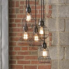 Industrial Cage Work Light Chandelier. I LOVE THIS. Over a large pine table in the dining area? Too much? Too verticle?