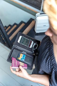 Luxury travel wallet with RFID protection keeps all your travel documents such as passport, tickets and money safe. With 4 slots for cards, a pen loop, and space for your mobile phone on the right side. Money Safe, Luxury Travel, Travel Bags, Passport, Wallet, Space, Phone, Cards, Travel Handbags