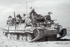 A Valentine tank in North Africa carrying British infantry