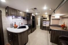 """2016 Open Range Ultra Lite 2704BH Travel Trailer with Bunks by Highland Ridge, The main bedroom features a 60""""x80"""" Convertible Queen bed with an extension, as well as overhead cabinets, hanging wardrobes, and night stands."""