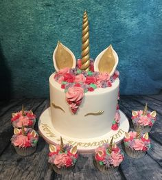 Pink unicorn cake and cupcakes by Meme's Cakes