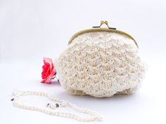 http://cottonandcloud.com/blog/cotton-cloud-beaded-knitted-purse-simply-homemade-issue-3/