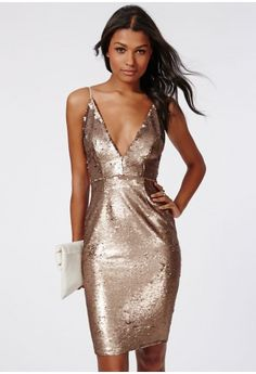 Standout this party season in this luxe strappy sequin dress. With plunging V neckline, adjustable straps and dainty gold sequin discs covering this dress is the definition of party. Style with towering strappy heels and feather clutch for ...