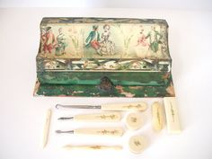 Lovely old vanity set with paper covered wooden box and celluloid vanity pieces