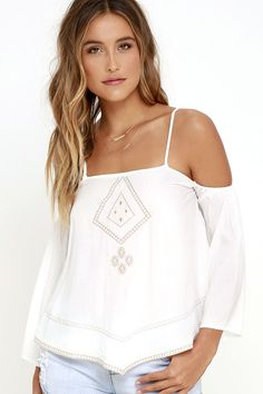 The perfect start to any day begins with coffee and cream, and the Morning Perk Ivory Embroidered Top! Taupe and pale pink geometric embroidery decorates this breezy, woven rayon top with a pointed hem. Spaghetti straps and long sleeves (with a bit of elastic) create a cute, cold shoulder look. Back keyhole with top button.