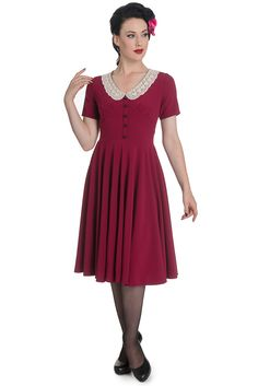 A beautiful and so elegant vintage classic Dress by Hell Bunny, Juliana dress features a round neckline with a crochet collar, button down detail along the bodice, short sleeves, and a full swing skir