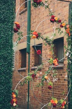 Other ideas for getting flowers outside - threading/attaching onto metal hoops - reflects the circus feel too?