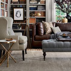 This is the Williams Sonoma home ottoman, but what I want you to see is geometric print on wingback chair. That's the fabric we'd use on ottoman. Fairfax Large Bench Ottoman, Turned Leg with Tufted Top | Williams-Sonoma