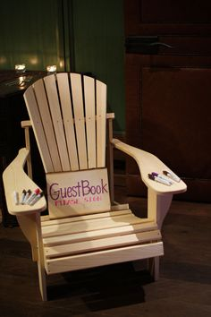 Guests signing a deck chair as guestbook. most original idea i've seen.. BRILLIANT!