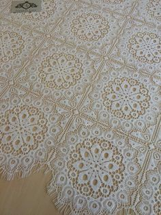 Ivory Lace Fabric, French Lace, Embroidered lace, Wedding Lace, Bridal lace, ivory Lace, Veil lace, Lingerie Lace Chantilly Lace  Article: B00113 Width: 115 cm(45.28 inches) Colors: Ivory Style: Spanish Lace edge: Both sides scalloped  Sold per meters (100cm x 140 cm) If you need a different amount, please contact us.   Perfect for dress, tops, wedding veil. You can split the piece up and have one scalloped edge around the veil and will place the separate flowers throughout the piece…