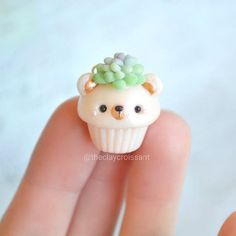 bear Cupcake - brushed the bear with pearl dust and his ears and nose were gently painted with gold paint.  #polymerclay