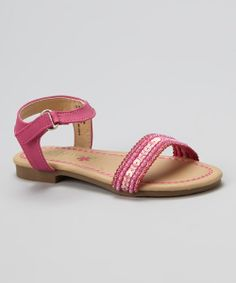 Does she love all things pretty and sparkly? Of course she does! These beaded, sequin sandals add delightfully bright character to her ensemble.