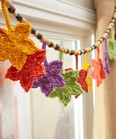 Crocheted leaves in gorgeous fall shades make the perfect banner. Whether you hang it at the window, on the mantel, above the bed or to add color to your work environment, you'll love having this banner this year and for years to come. Strung on hemp cord with wood beads gives it the perfect natural touch!