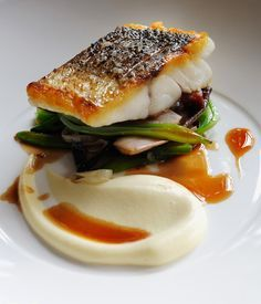 Escalope of wild sea bass with sautéed smoked bacon, red chicory, runner beans . Escalope of wild sea bass with sautéed smoked bacon, red chicory, runner beans and red wine sauce Fish Recipes, Seafood Recipes, Gourmet Recipes, Cooking Recipes, Gourmet Foods, Gourmet Desserts, Plated Desserts, Gourmet Food Plating, Gourmet Cooking