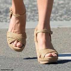 """Kate wearing her Stuart Weitzman """"Minx"""" wedges with a 4 1/2"""" heel and 1"""" platform, natural cork wedge, and rubber sole."""