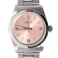 This is an authentic ROLEX Stainless Steel Oyster Perpetual Midsize 30mm Quartz Watch. This classic Rolex is crafted of stainless steel with a metallic pink face.