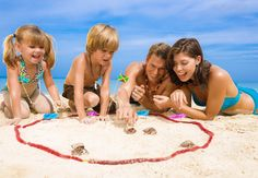 Family on the beach, playing in the sand at the beaches negril family resort, Beaches Resort Jamaica, Jamaica Vacation, Us Beaches, Beach Resorts, Family Vacation Packages, All Inclusive Vacation Packages, Family Vacations, Family Beach Pictures, Beach Photos