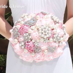 This brooch bouquet is handcrafted with beautiful brooches, colorful satin ribbon flowers in perfect combination of dark and light pink, and lustrous pearls. This product is mad Wedding Brooch Bouquets, Bride Bouquets, Prom Flowers, Wedding Flowers, Romantic Wedding Colors, Renewal Wedding, Satin Ribbon Flowers, Alternative Bouquet, Pink Bouquet