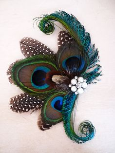 Hey, I found this really awesome Etsy listing at https://www.etsy.com/listing/193095697/peacock-feather-fascinator-hair-clip