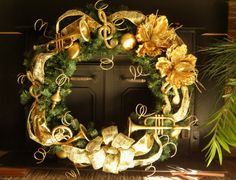 This gloriously elegant and sparkly wreath will be a great addition to your traditional holiday decor! Perfect for your home or your workplace! This is just the gift for that special band director or musician in your life that needs to complete their holiday look! Sure to please!  This is a fantastic, large 30 inch round, handmade wreath. Incorporates gold, glittery Magnolia flowers, ribbons, and multiple shatterproof ornaments.