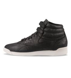 the latest a9976 6dcfa This Lux edition of the mid top Reebok Freestyle has premium soft leather  uppers for luxurious comfort. They also have extra padding around the ankle  for ...