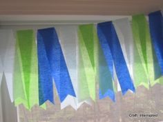 Craft, Interrupted: Monkey Party - Banner made out of folded strips of crepe paper streamers sewn together and notched
