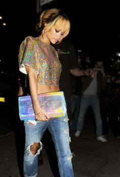 "Rihanna Fashion Style! Literally wearing the prettiest sparkly tee the world has seen! Cute ripped denim jeans, nice carry-purse... matches the top. An overall ""just out for a martini"" feel to the outfit. Or let's go to the mall?"