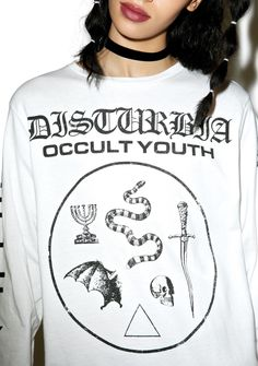Disturbia Occult Youth Longsleeve Tee cuz yer a new breed of millennial that's wicked as f*xk. This devilish long sleeve crewneck tee features an oversized fit, rounded neckline, Disturbia branding, Satanic symbols all down the arms and chest, and a giant graphic on the back of a snake wrapped around a dagger.