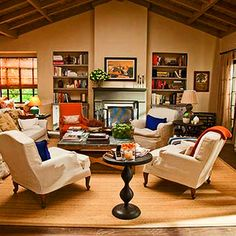 """Set from the movie, """"It's Complicated."""" Though I'm partial to Craftsman bungalows, I love the idea of this (would-be multi-million dollar) Spanish Ranch home. Totally digging the pops of orange and the vaulted wood ceiling. Also love the idea of so many arm chairs."""
