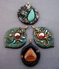 Four pendants made with black polymer clay brushed with metallic paint. The two leaves were a custom order. The top pendant is made with frosted blue glass and a blue coral fossil cabochon. The bot...