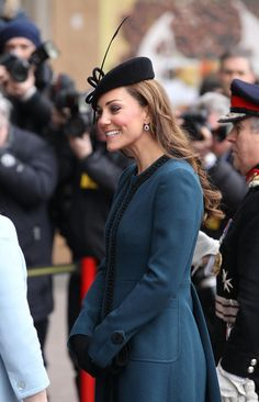 Catherine Duchess of Cambridge, aka Kate Middleton, wearing a teal coat by  Malene Birger, hat by Whiteley, and Episode 'Angel' suede heals. Kate joined HM the Queen and Prince Philip to visit the Baker Street Station on the Underground, 3/20/13.