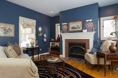 tradiitonal-living-room-with-fireplace-and-painted-blue-walls