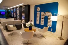 LinkedIn is a social networking site that connects business professionals around the world. At the company's Gurgaon office, the golden tones of different F+. Microsoft, Smart Strategy, Cool Office Space, Office Looks, Ibm, Office Interiors, Empire State Building, Furniture Sets, Office Furniture