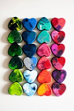 "Little Valentines made out of melted crayons. Wording ideas: ""For Crayon Out Loud, Happy Valentine's Day""... could also say, ""You COLOR my world!"" Use silicone cups to melt them in."