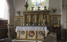 Blisland church, Cornwall  Rererdos is by Ninian Comper who was responsible for many church interiors. He was also an architect and designed St Cyprian's, Clarence Gate, Regents Park, London.