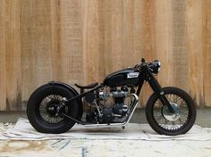 Triumph bobber, looks sweet but a rigid third light would be murder on I10
