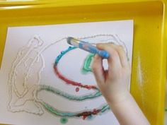 There must be hundreds of ways to use salt in the classroom and the children found this idea particularly interesting to explore...    To begin this process, the children created random designs by squeezing lines of glue on their paper. We found