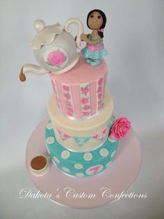 Tea party cake made for my daughter's 7th birthday.  Frosted in buttercream with fondant accents.  Roses are hand painted.