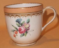 "CHELSEA DERBY FLORAL COFFEE CUP C1770-75  |  made by Chelsea Derby , during the 2 factories merger , circa 1770-75 , and bears the joined anchor and D mark , on the base . It is nicely handpainted with handpainted bouquets of flowers with a salmon border and enriched with gilding . It stands at 2 5/8"" high . It is in good condition with no chips , cracks or restoration and the gilding is good 84.00"