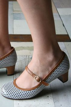 Chie Mihara shoes are my favorite. I can wear them all day for work and they actually go small enough for me.