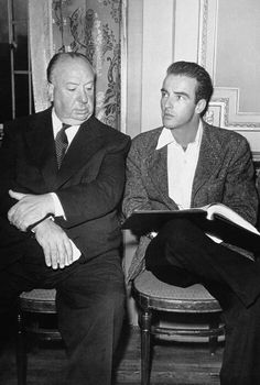 Alfred Hitchcock and Montgomery Clift on the set of I CONFESS (1953)