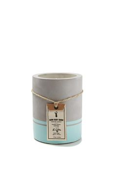 Keep your space smelling like a tropical cocktail with this printed cement candle. <br> Made from cement and filled with hand poured soy wax, once this is finished burning you use the holder to store pens, pencils etc. <br> Mango guava fragrance. Burns for approx 60 hours. <br> Dimensions: 12cm H x 9cm W. <br/>