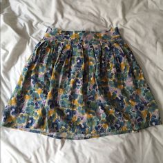 Watercolor Floral Skirt In perfect condition. Size xsmall but with elastic waist so will also fit a small. Offers welcome, sorry no trades! Frenchi Skirts Circle & Skater