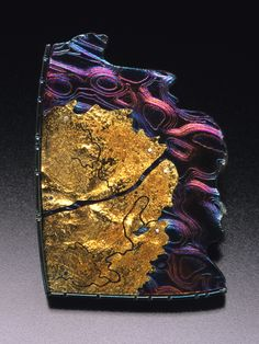 Joan Tenenbaum's Delta View: Tidelands Brooch IV is made of 18k gold, copper/sterling silver mokume gane, and sterling silver. Inspiration for this piece came from photographs of tidal flats and the many aerial views she has seen while traveling in rural Alaska. 1 3⁄4 x 1 1⁄4 x 3/16 in. (44 x 32 x 5 mm). Photo by Doug Yaple. This appeared in the March 2008 issue of Art Jewelry.