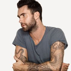 Adam Levine....in honor of his recent singleness. Skin Envy with the scruff & all.