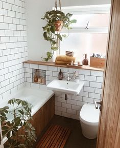 Small bathroom ideas, subway tiles, houseplants, wooden bath panel – Best Home Plants Wood Bathroom, Bathroom Interior, Bathroom Inspo, Bathroom Cabinets, Master Bathroom, Small Bathroom With Bath, 1950s Bathroom, Bathroom Storage, Modern Bathroom